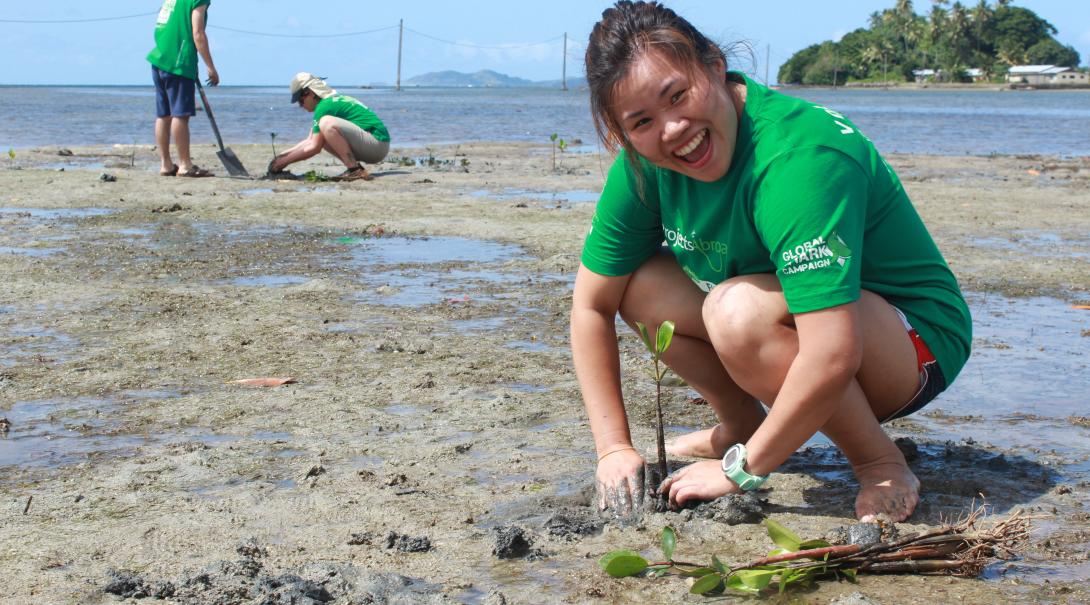 Projects Abroad Conservation volunteer plants a mangrove in Fiji